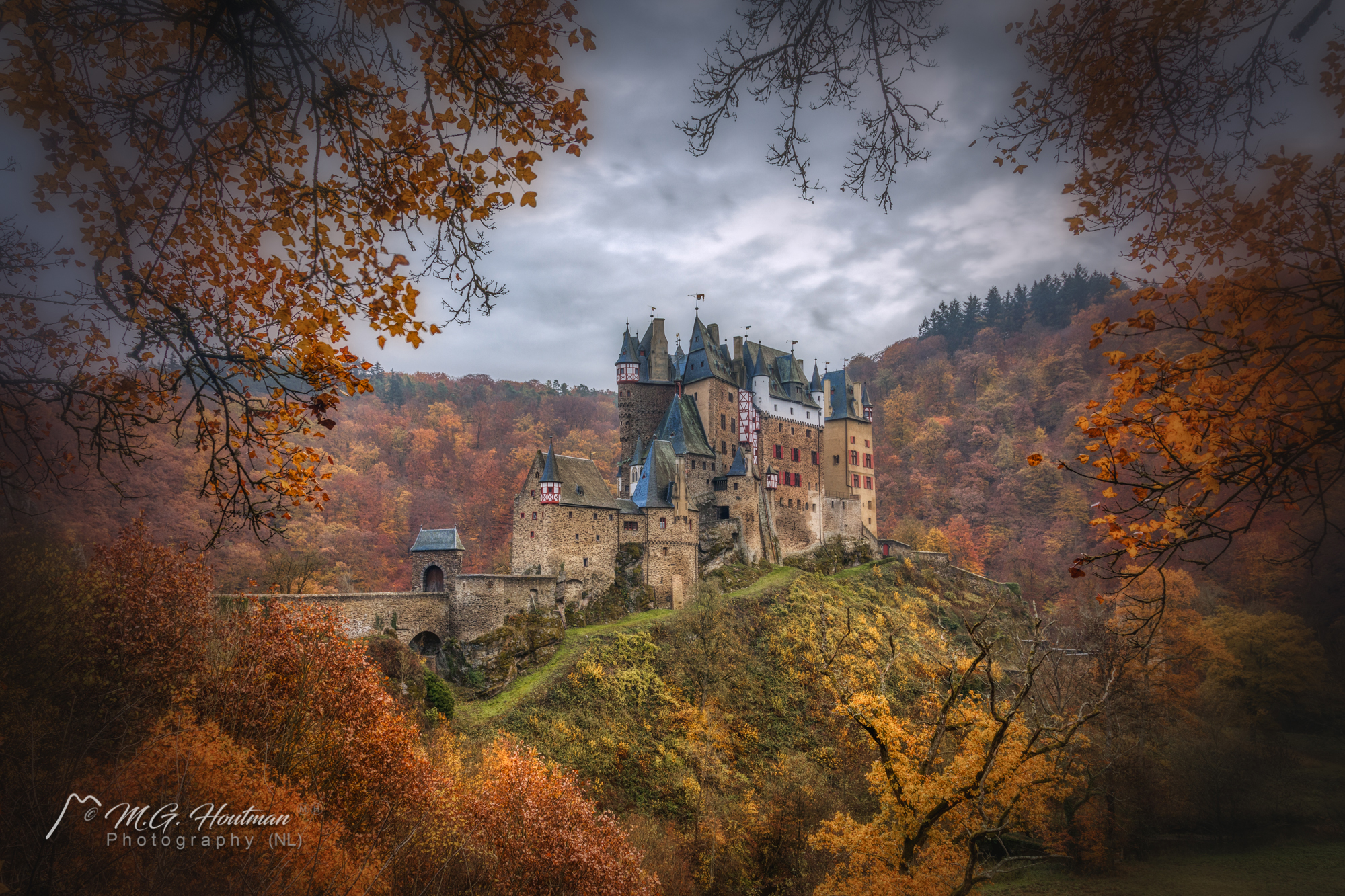 Eltz Castle (German: Burg Eltz) is a medieval castle nestled in the hills above the Moselle River between Koblenz and Trier, Germany. It is still owned by a branch of the same family (the Eltz family) that lived there in the 12th century, 33 generations ago. Bürresheim Castle (Schloss Bürresheim), Eltz Castle and Lissingen Castle are the only castles on the left bank of the Rhine in Rhineland-Palatinate which have never been destroyed.